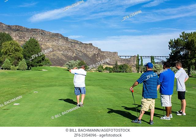 Twin Falls Idaho beautiful exclusive Blue Lake Country Club in valley of mountain and expensive and private golf course with golfers playing