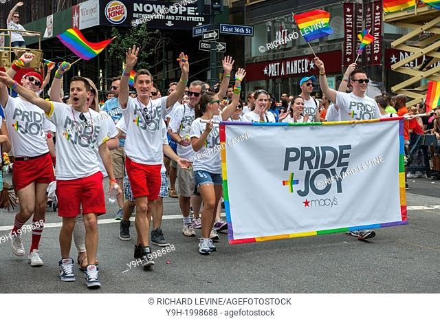 Macy's workers march in the 44th annual Lesbian, Gay, Bisexual and Transgender Pride Parade on Fifth Avenue in New York. The turn out for the parade was...