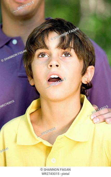 Boy looking up in wonder