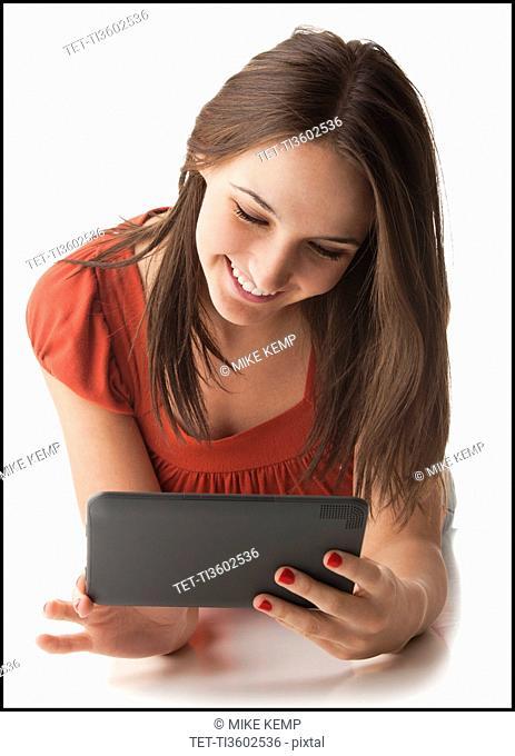 Young woman using electronic organizer
