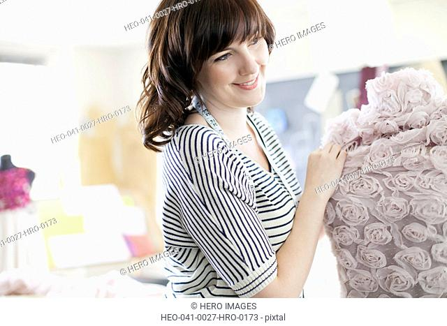 clothing designer putting fabric on dress form