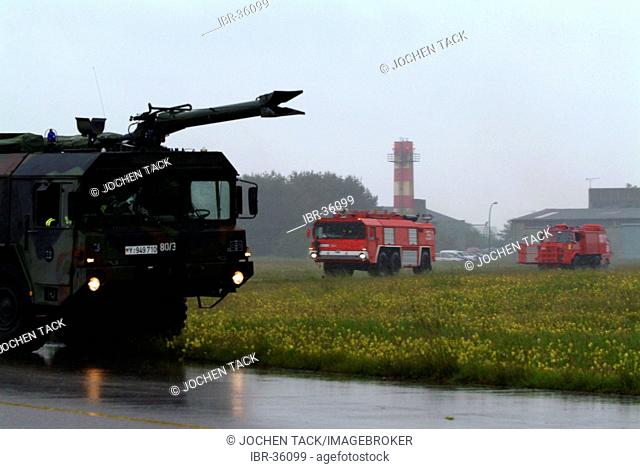 DEU, Federal Republic of Germany, Lagerlechfeld: Rescue exercise of the airport fire service of the german airforce. A fighter jet, typ Tornado