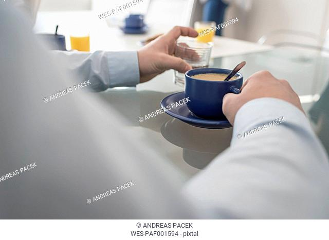 Man having a coffee break in office