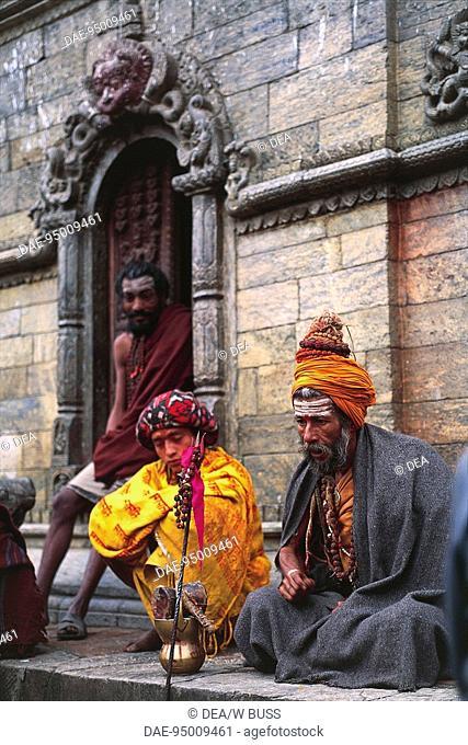Nepal - Kathmandu Valley - Pashupatinath. Sadhu (holy man)outside a temple