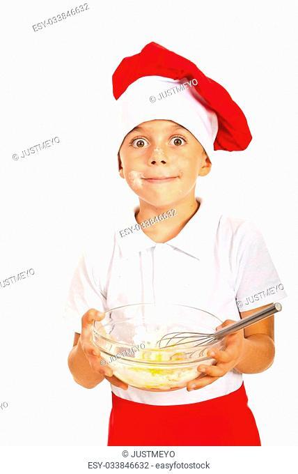 Amazed chef boy holding dough isolated on white background