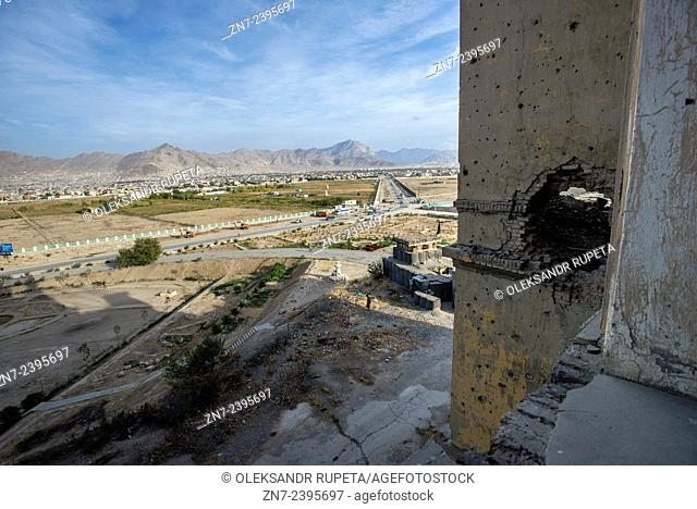 The hole in the wall of Darul Aman Palace after the hit of the shell during Mujahideen factions fought for control of Kabul in the early 1990s, Kabul