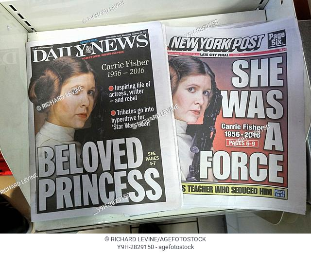 Front pages and headlines of the New York tabloid newspapers report on the previous days' death of Carrie Fisher after suffering a heart attack during a flight