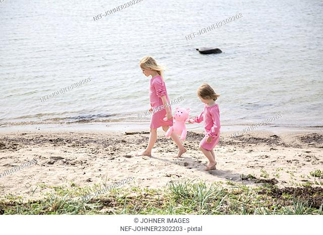 Girls walking at sea