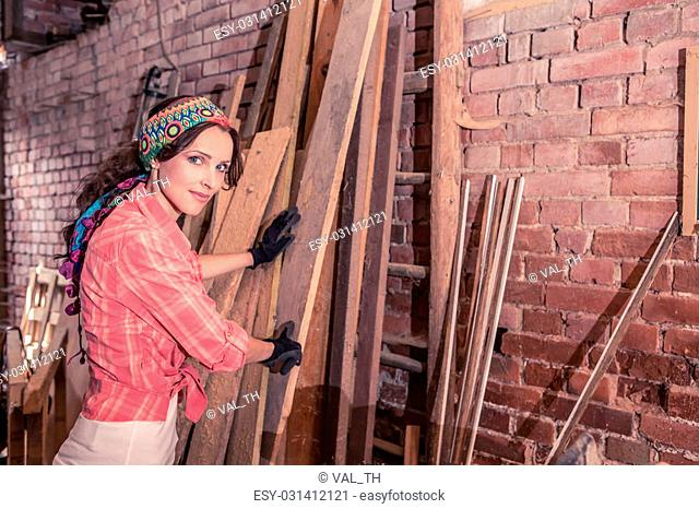 portrait of a young woman in the old barn