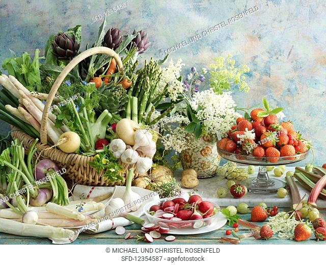Still life with spring vegetables and strawberries