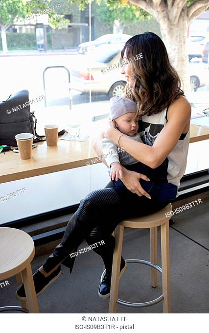Mother sitting in cafe with young son
