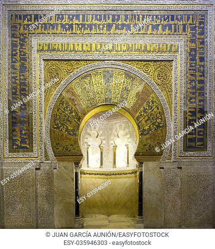 Richly gilded prayer niche or Mihrab of Cordoba Mosque. Andalusia, Spain