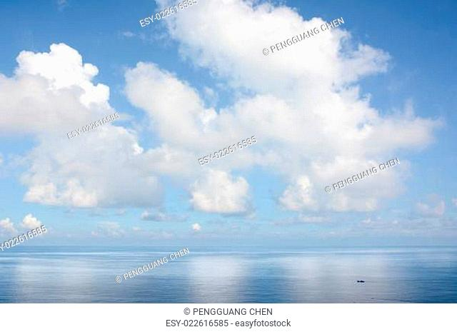 Clouds above a surface of the sea