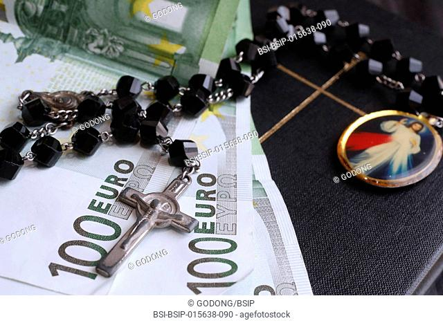 Money and religion. Holy bible and euros. Money and religion. Holy bible and euros