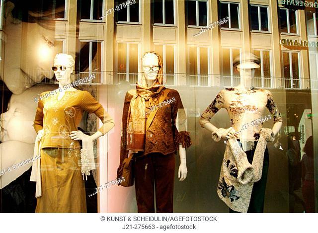 Reflection  in a shop window. Munich, Germany