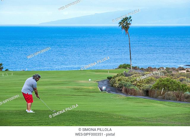 Spain, Tenerife, Golf player at Costa Adeje