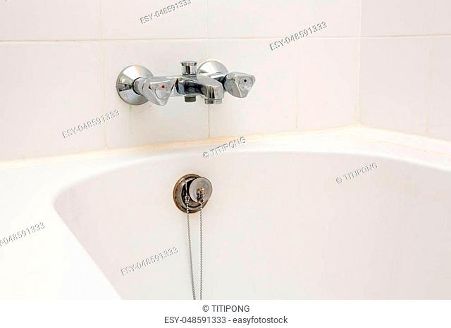 Luxury bath tub and faucet with water