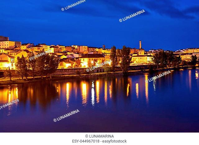 Zamora skyline at sunset by Duero river of Spain