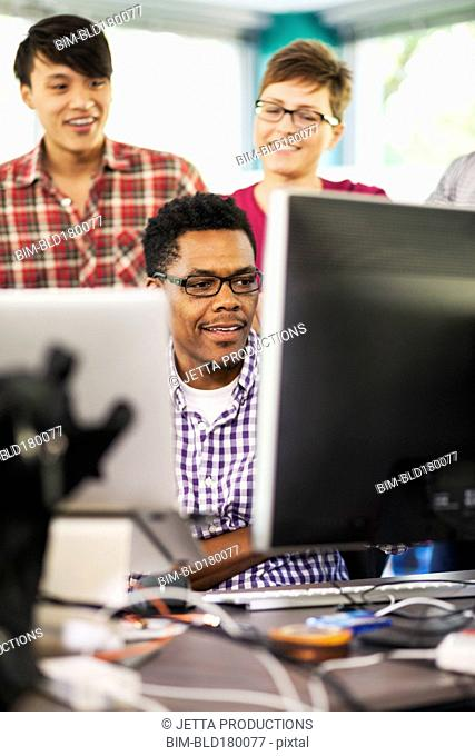 Business people working in office with computer