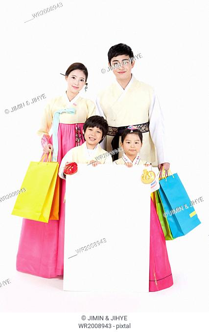 a traditional Korean family posing with a copy space