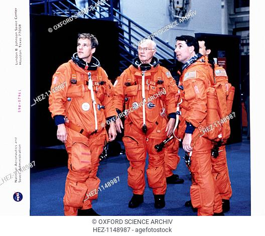John H Glenn and crew members, June 1998. Wearing training versions of the Space Shuttle partial pressure launch and entry suit are (from the left) Scott...