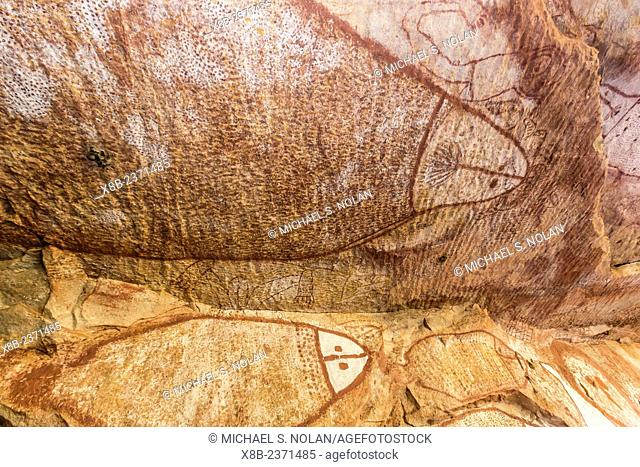 Aboriginal Wandjina cave artwork in sandstone caves at Raft Point, Kimberley, Western Australia, Australia