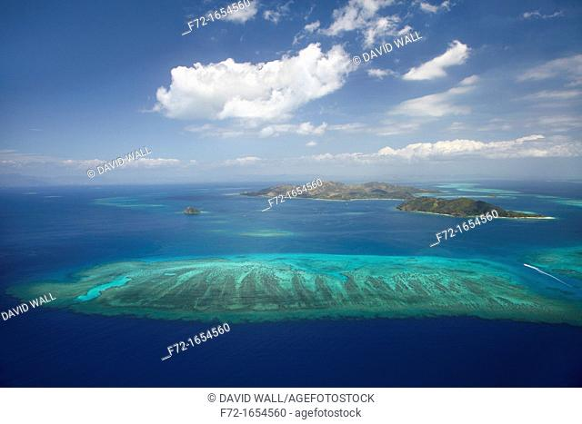 Aerial view of barrier reef of Malolo Island centre and Castaway Island right, Mamanuca Islands, Fiji