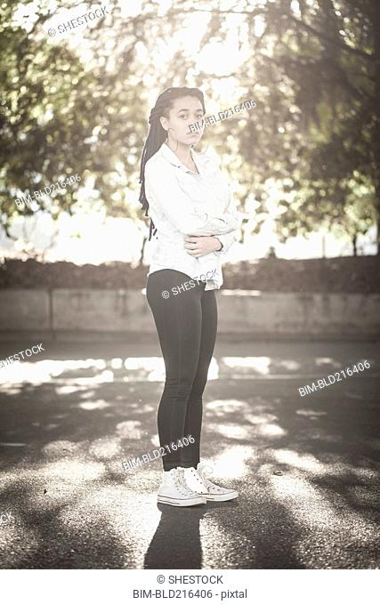 Serious woman standing outdoors