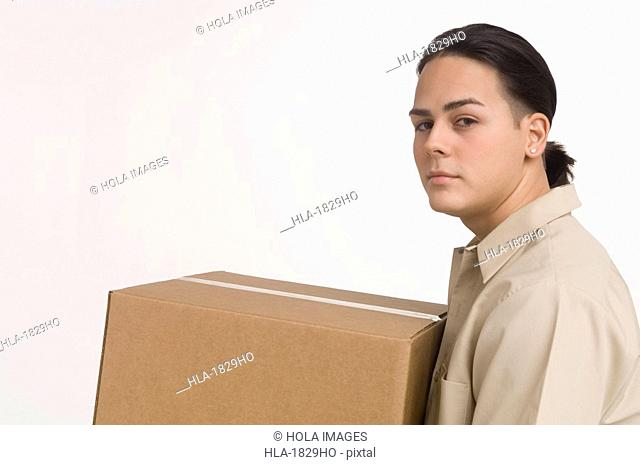 Delivery man carrying large box