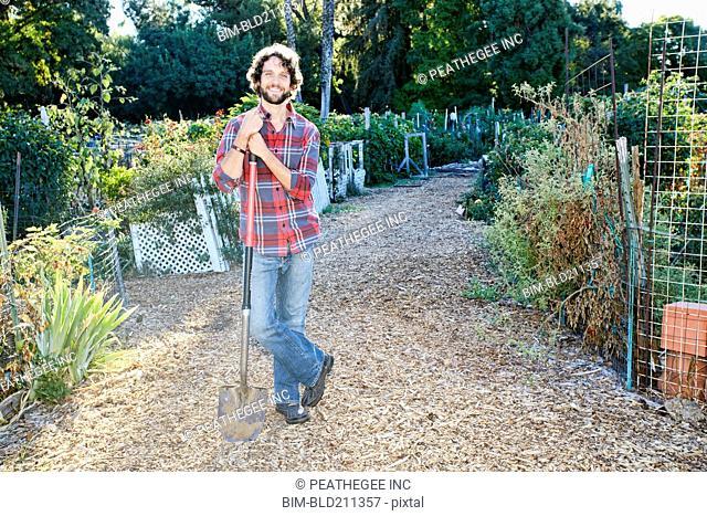 Caucasian man standing in garden