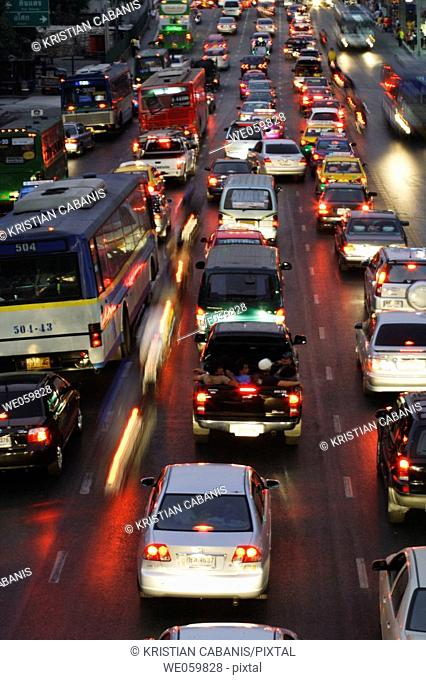 Rush hour with traffic jam at the early evening on Rajadamri Road at the World Trade Centre of Bangkok, Thailand, Southeast Asia