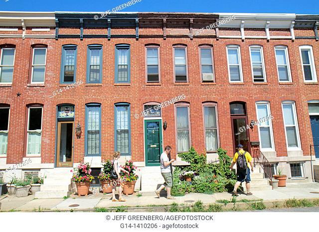 Maryland, Baltimore, Federal Hill, historic neighborhood, townhouse, row house, townhome, red brick, sidewalk, door, window, flower pot, door, tree, woman, man