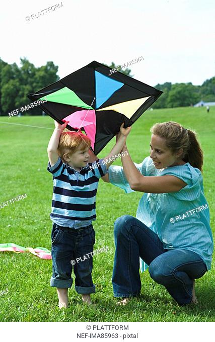 Mother and son playing with kite