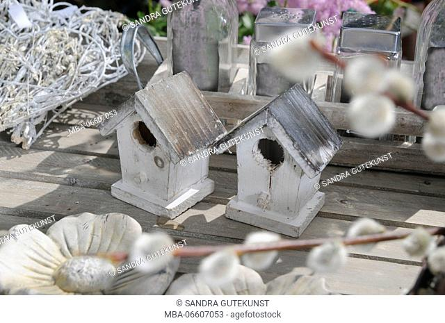 nesting box on wooden table and spring decoration exterior shot, close-up