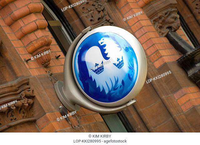 England, North Yorkshire, York, A Barclays bank sign mounted on a wall outside a branch of the bank