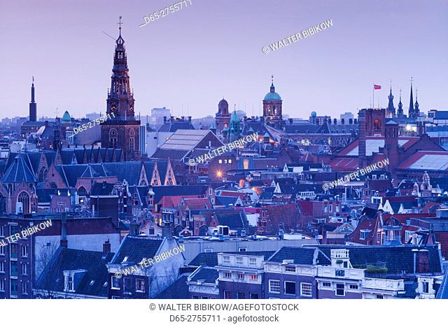 Netherlands, Amsterdam, elevated city skyline from the north, dusk