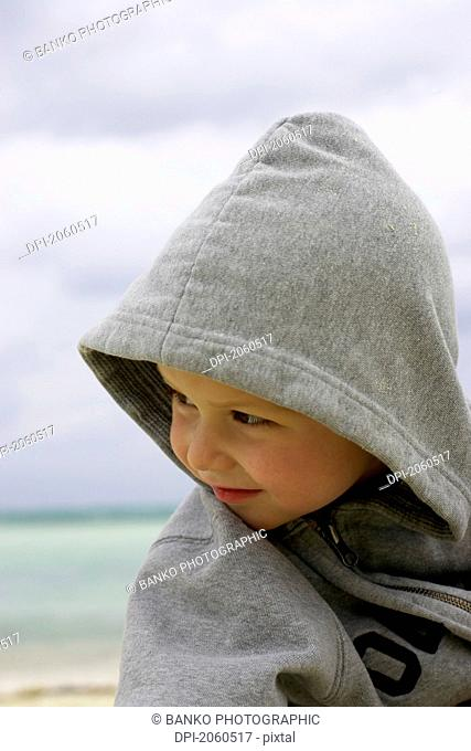 Boy In Hoodie On The Beach, Camaguey, Cuba