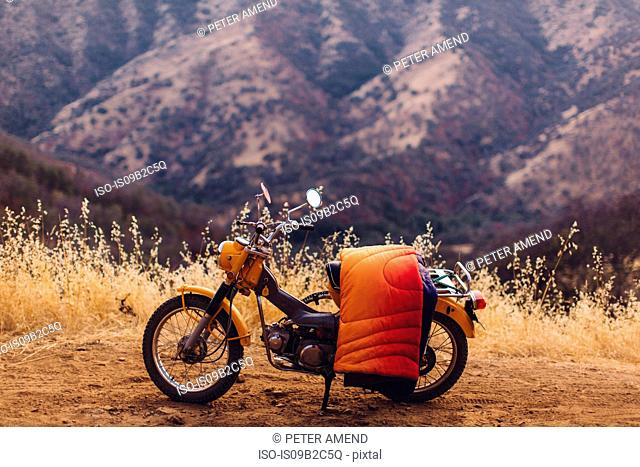 Motorbike with blanket over seat, Sequoia National Park, California, USA