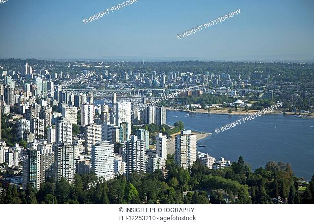 Aerial view of downtown buildings and False Creek; Vancouver, British Columbia, Canada