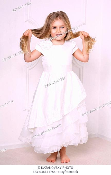 Little girl in dress holding her hair, girls dresses, kids clothes, wedding dress, baby wearing, cute baby, baby in studio, white background