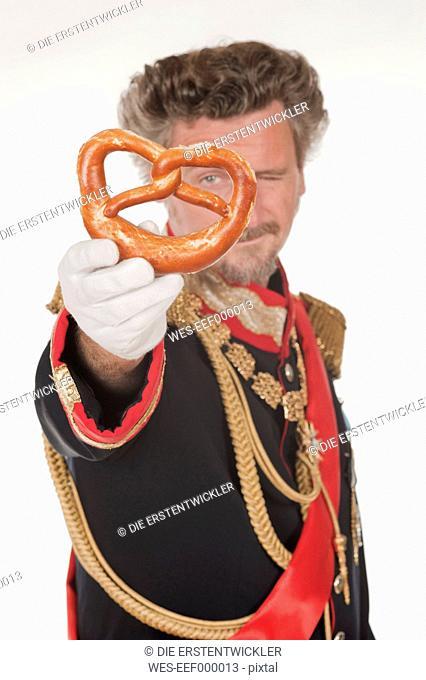 Man as King Ludwig of Bavaria with pretzel