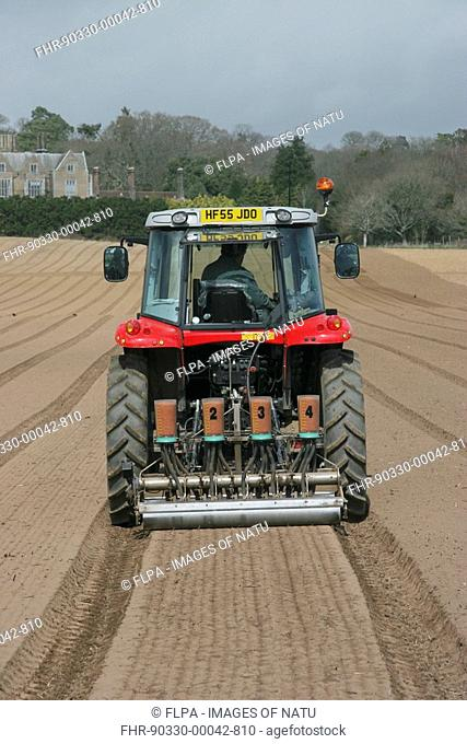 Drilling salad spinach in field, coated seed and drill, Dorset, England