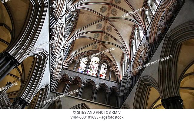 TILT up and PAN, LA, interior, decorated rib-vaulted ceiling above the Choir Quire. The current vaulting decoration was an attempt by Sir George Gilbert Scott...