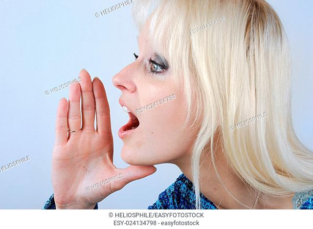 Young blonde woman with a cry