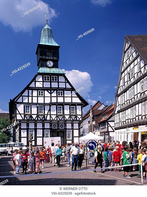 D-Uslar, Schwuelme, Ahle, Solling, Weserbergland, Lower Saxony, city hall with clock tower, half-timbered houses, pedestrian zone, people, children, freetime
