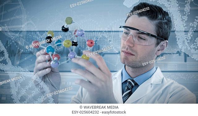 Composite image of scientist experimenting molecule structure