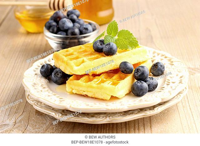 Waffles with syrup and blueberries. Summer party dessert