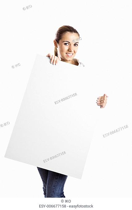 Portrait of a beautiful woman holding a blank billboard