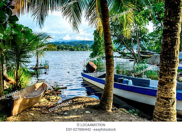 Boats in late afternoon light on Rio Dulce, Livingston, Guatemala