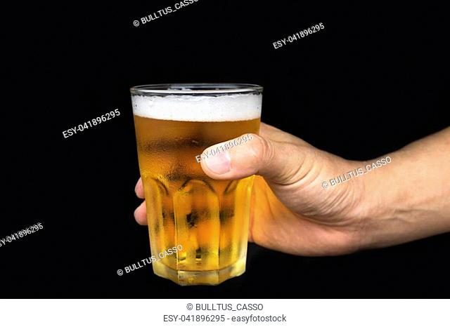 Man hand holding glass beer on isolated black background